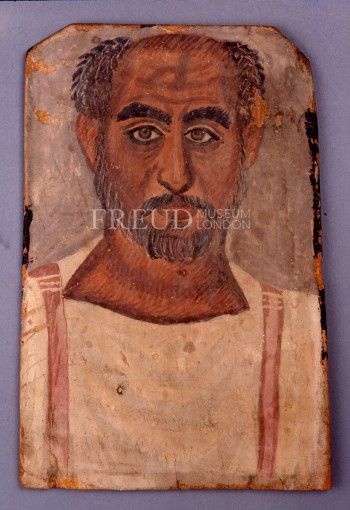 Mummy Portrait, Roman Period; c. A.D. 250-300 Culture: Egyptian Material: Tempera on wood Dimensions: 13 3/8 x 9 in. 34 x 23 cm