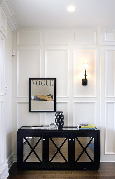 Chic Entryway With White Recessed Panel Wainscotting Iron