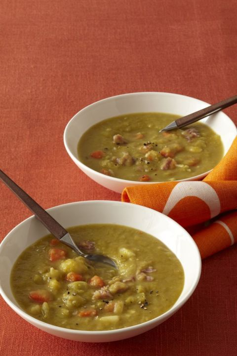 Slow Cooker Smoky Split Pea Soup: This hearty soup recipe is very versatile; feel free to load up with additional root veggies. If you don't care for ham hocks, simply top soup with crumbled bacon once it's done. Click through to find more easy and hearty slow cooker recipes for dinner.