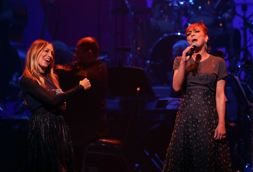 Sarah Jessica Parker Photos Photos - Sarah Jessica Parker (L) and Andrea McArdle perform during the Hillary Victory Fund - Stronger Together concert at St. James Theatre on October 17, 2016 in New York City. Broadway stars and celebrities performed during a fundraising concert for the Hillary Clinton campaign. - Fundraiser Event Held for Hillary Clinton's Presidential Campaign in Manhattan