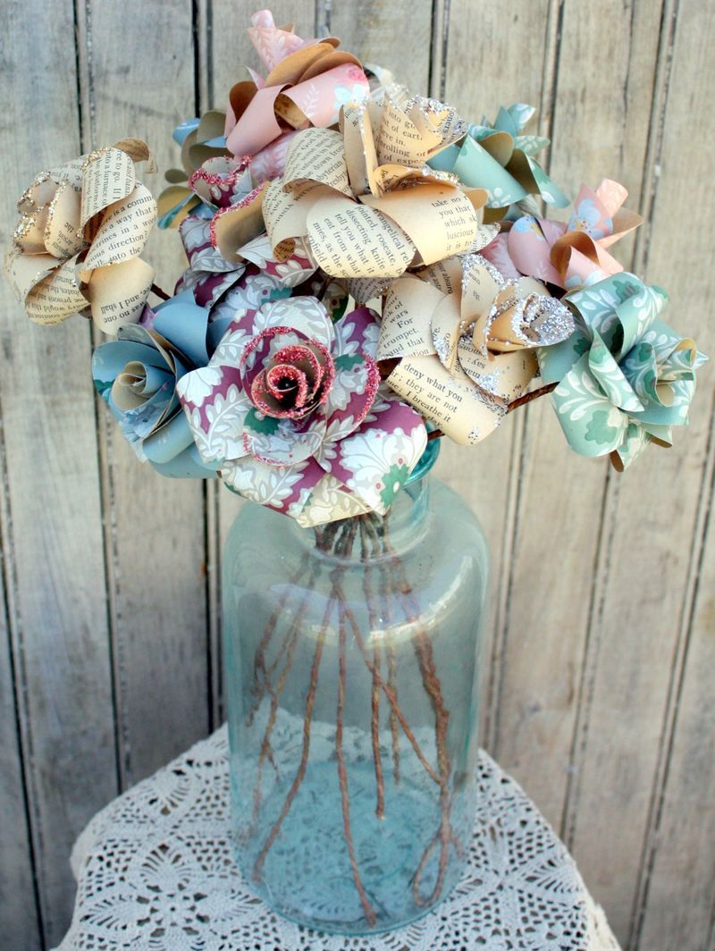 Vintage paper flowers using paper coated with mod podge by mitzi flowers can be expensive and time consuming to maintain so swap the live version in favor of this book page paper roses diy project grab an old book and mightylinksfo