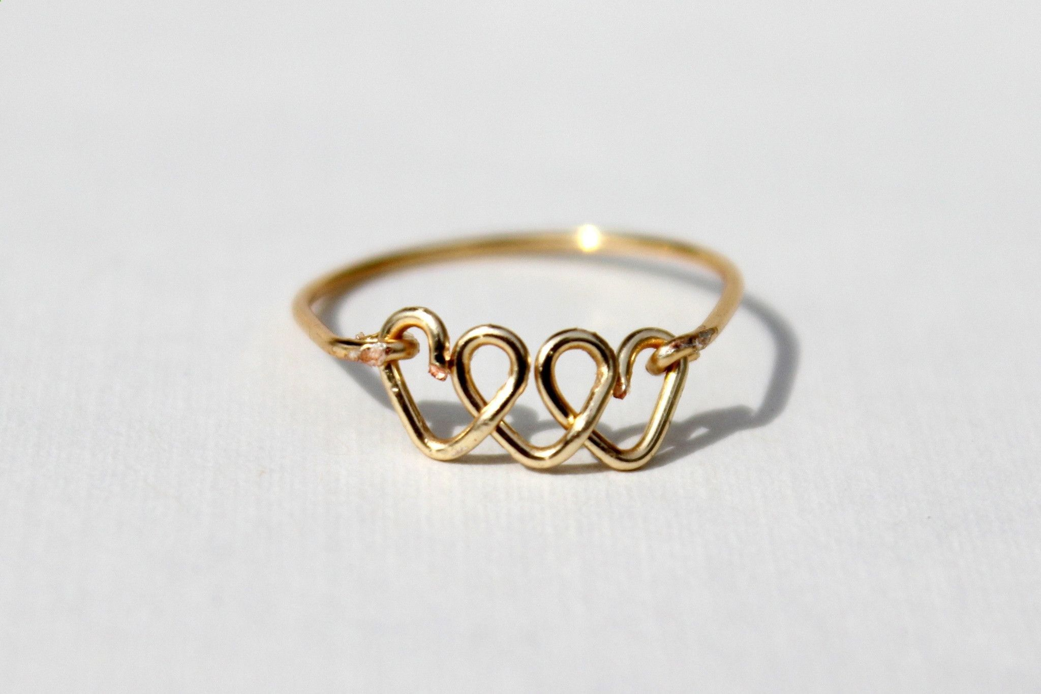 This is a gold triple heart ring made out of non-tarnish gold or ...