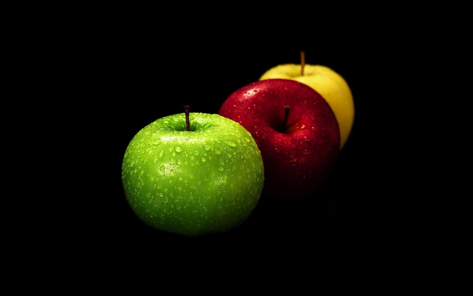 Green Red And Yellow Apple On Black Background Apple