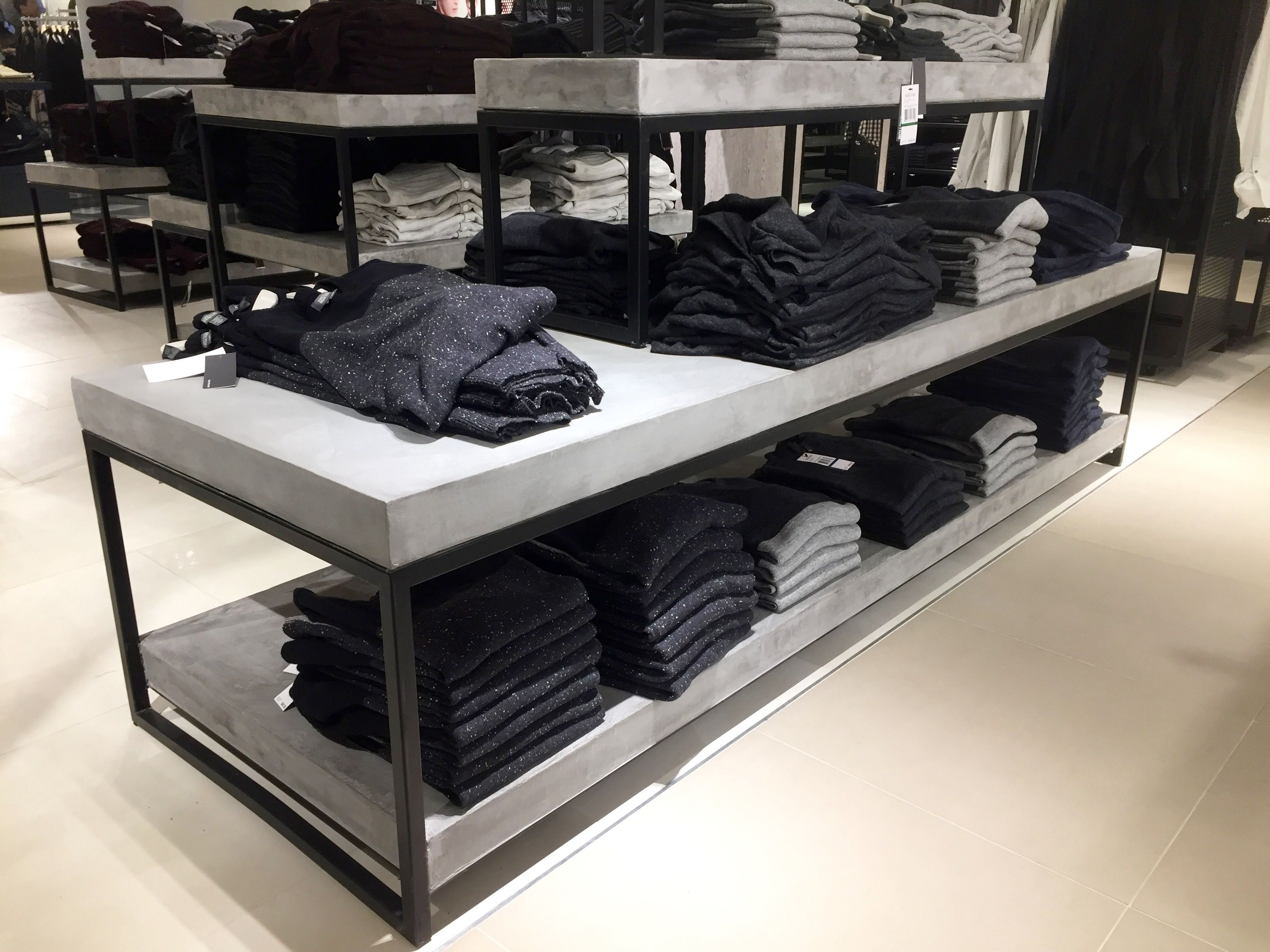 Macy's Herald Square in Manhattan. Display tables w/blackened steel bases and…