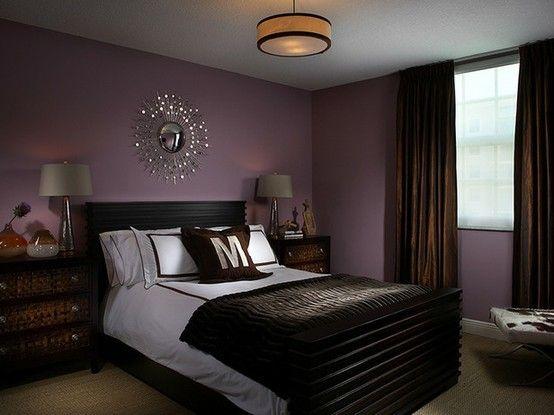 Masculine, dark bedroom with a hint of feminine purple kcher ...