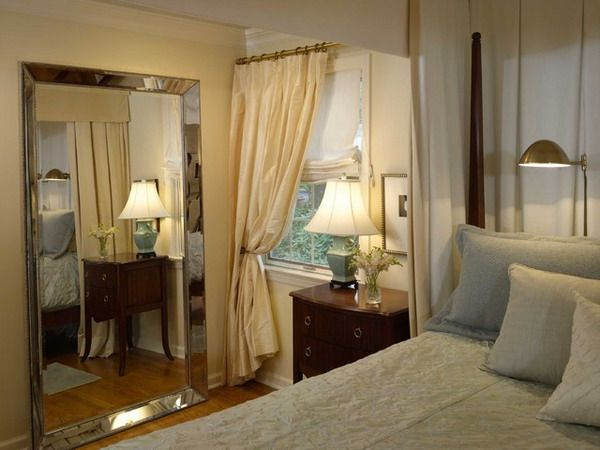 A large floor mirror can do wonders to a small bedroom. A large floor mirror can do wonders to a small bedroom    Large