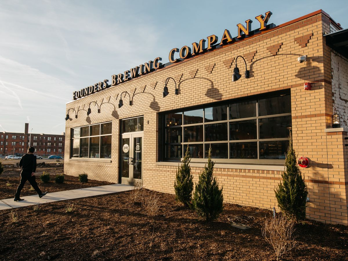 Founders employees gather in cass corridor to meet with