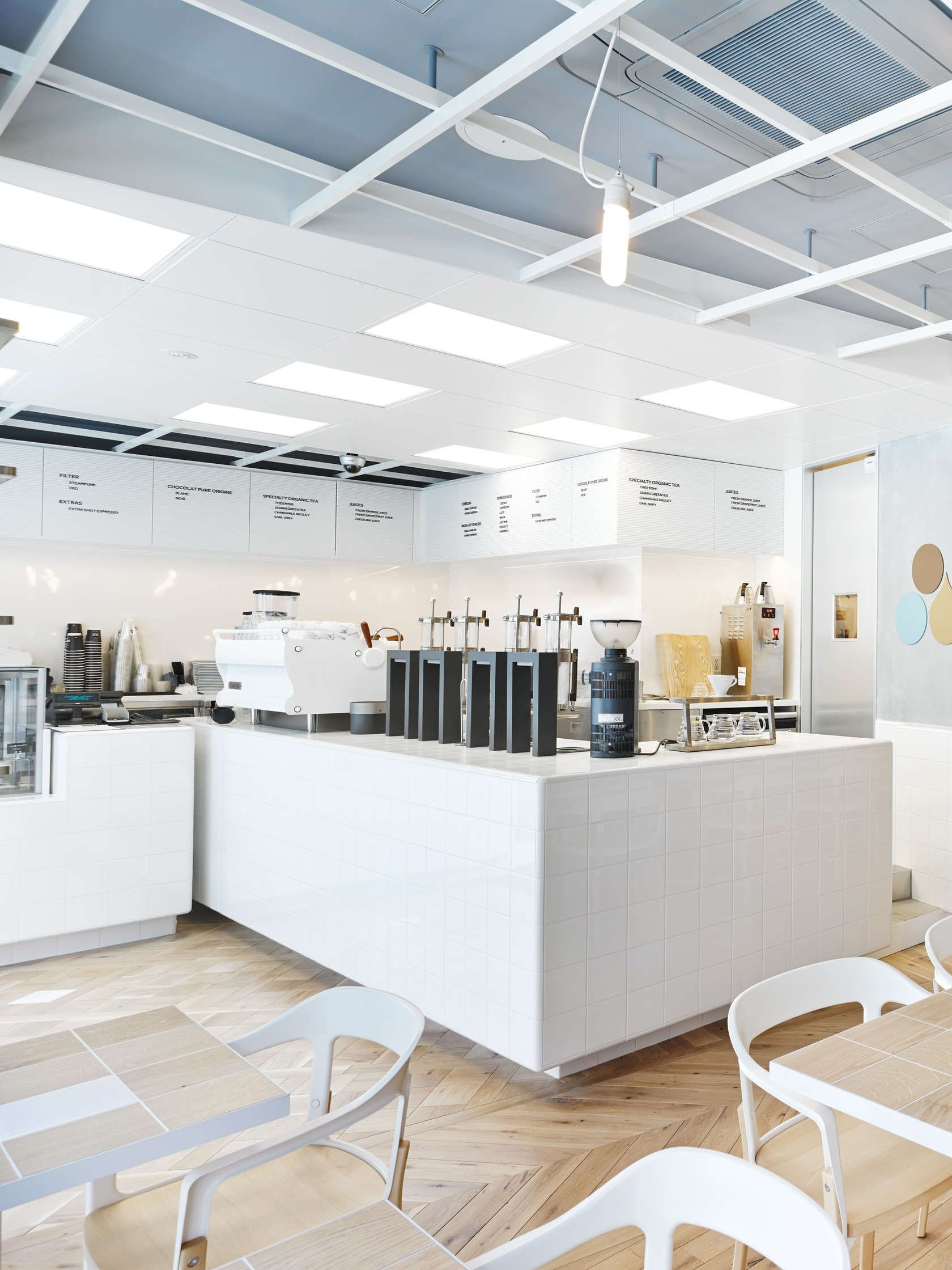 Love this laboratory inspired coffee bar and how they utilize a minimalist menu wrapped on the wall and simple square white tiles