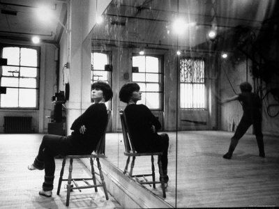 Choreographer Twyla Tharp Observing a Dancer Rehearse. Both Reflected in Mirror