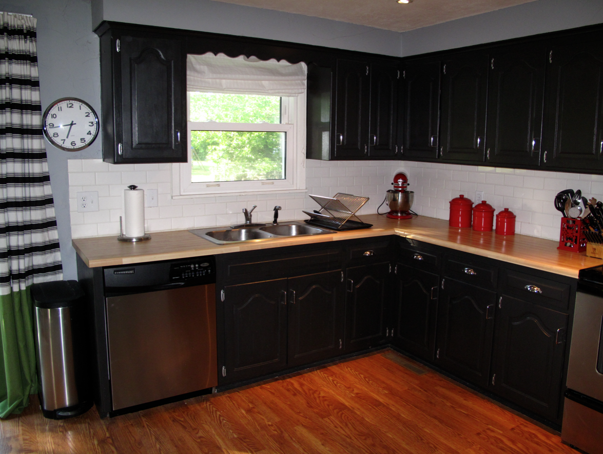 Thinking black cabinets with butcher block countertops for Small kitchen black cabinets