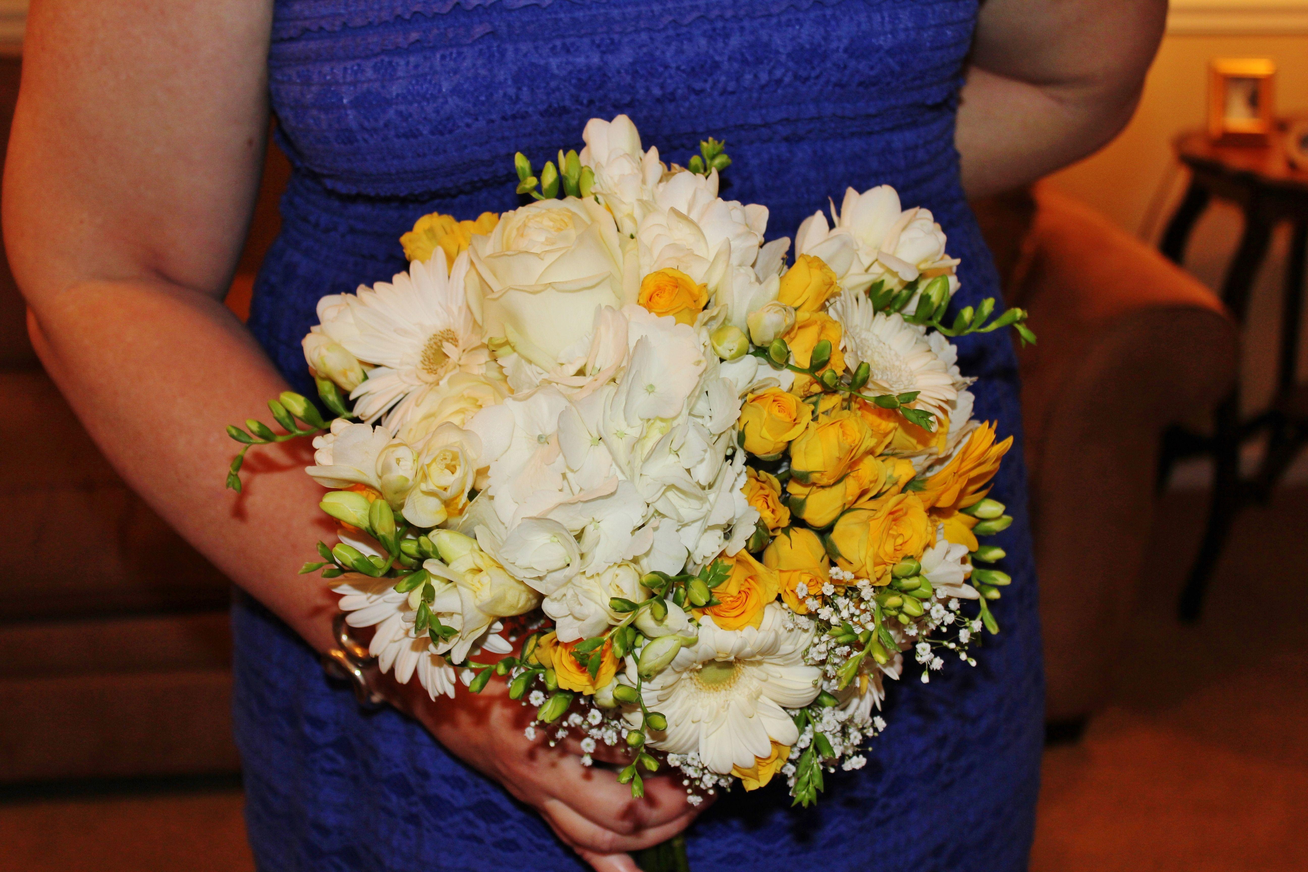 White and yellow bridal bouquet by Rockwall Wedding Chapel rockwallchapel.com