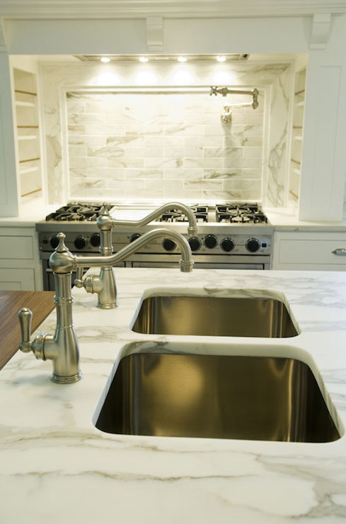 Chic Kitchen Island Design With Calcutta Marble Counter Tops Double Square Sinks Brushed Nickel Faucets And Pot Filler