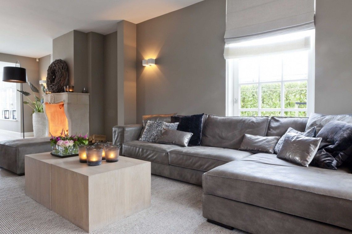 Cozy condo living rooms styling by  natural feeling  hoog  exclusieve woon en tuin