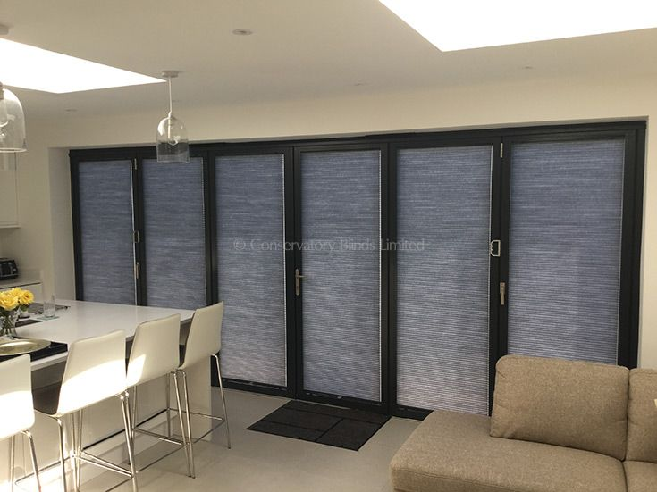 Duette® Pleated Blinds fitted into each panel of these bi-fold doors reducing heat and glare and dramatically improving privacy. & Duette® Pleated Blinds fitted into each panel of these bi-fold doors ...