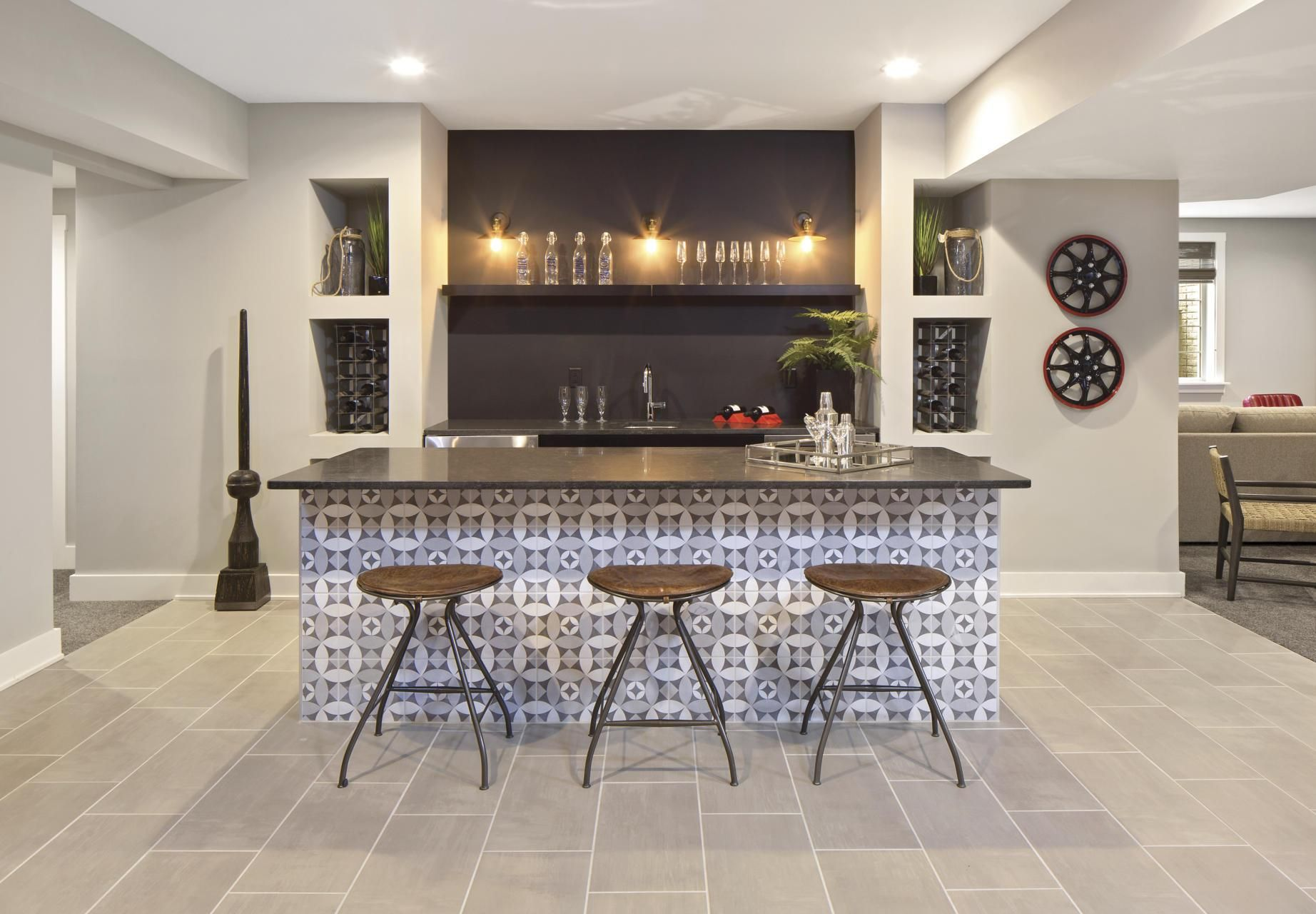 Wet Bar With Cabinets And Island Seating In Finished Basement