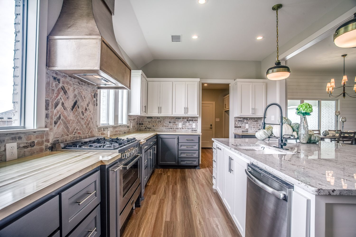 The Custom Range Hood Sits Atop A Commercial Grade Range Surrounded By Ample Cabinets This Kitchen Is As Functional Kitchen Custom Range Hood Kitchen Dining