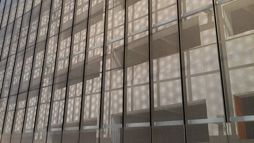 The Perforated Panel Creates A Moire Effect Against Its