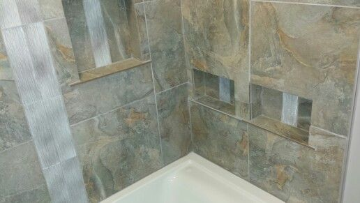 Built - in storage for shower and tub.