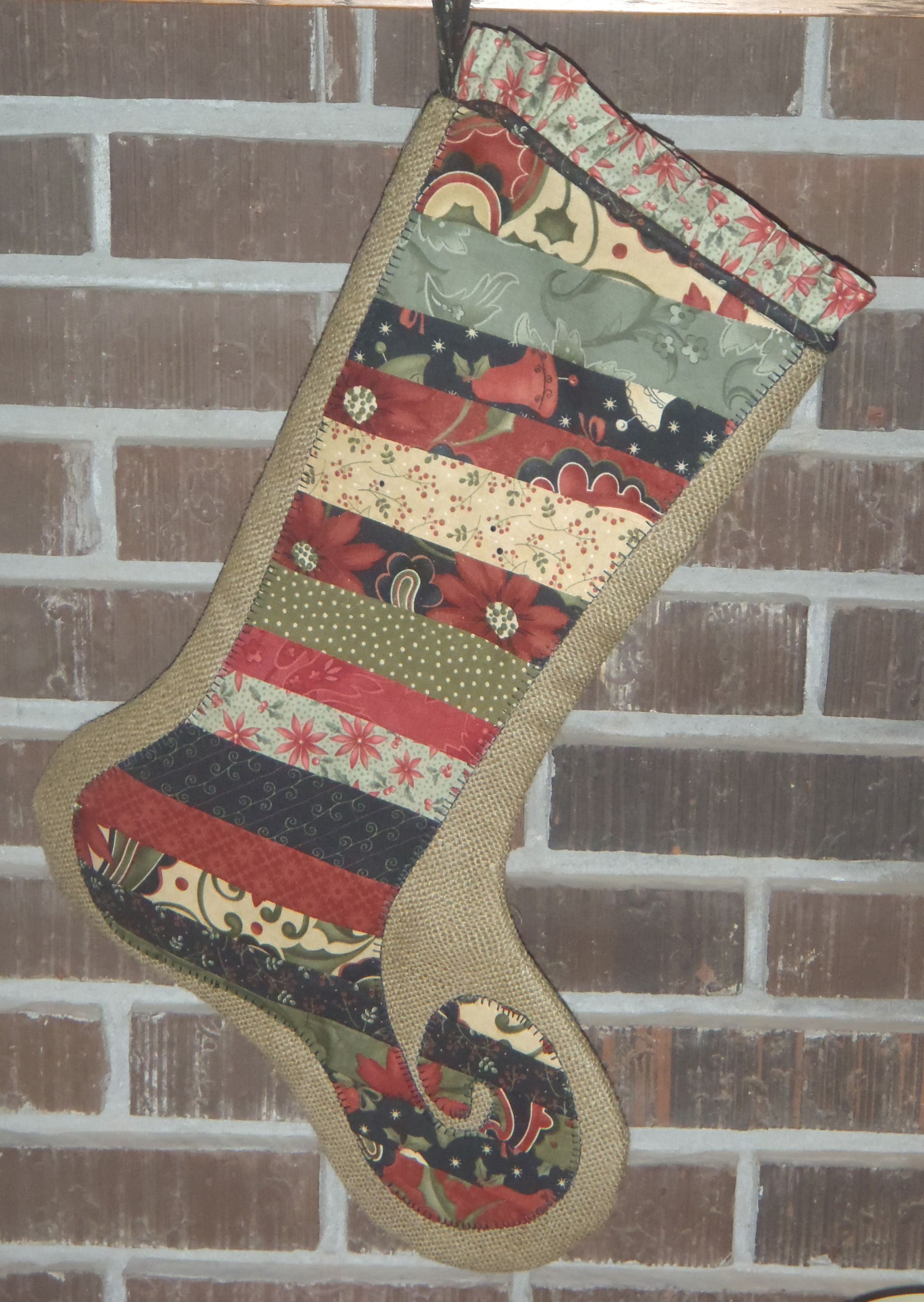 Scrappy Christmas stocking with burlap background.
