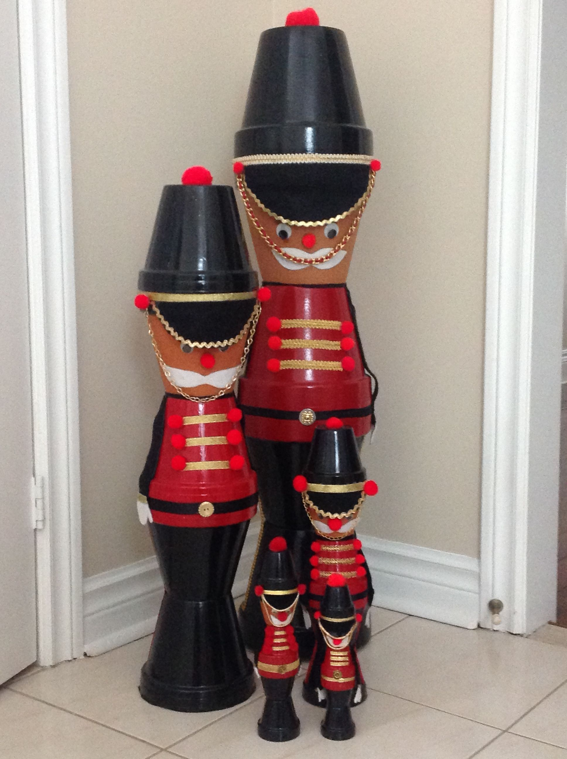 Nutcracker soldiers made from clay flower pots, they come