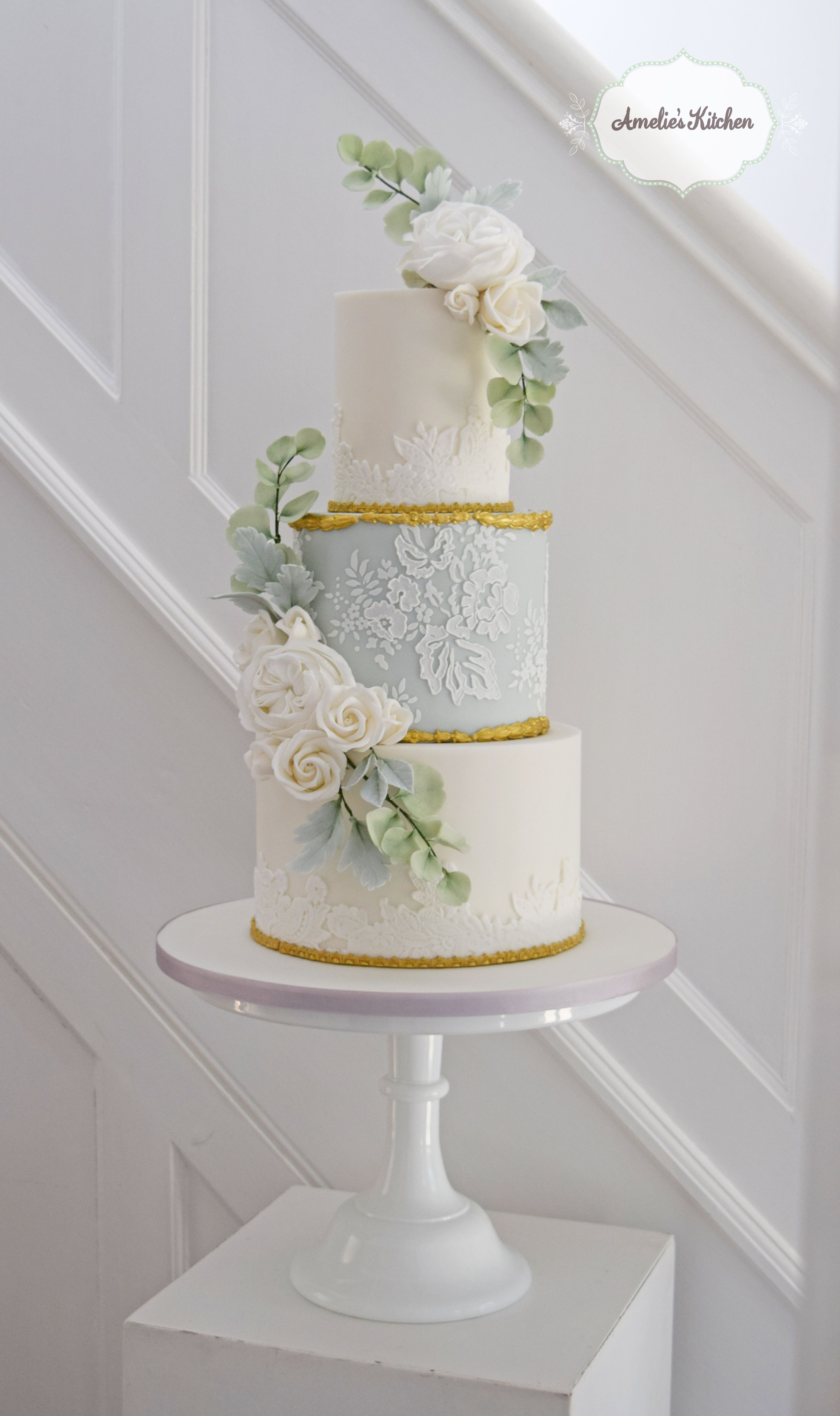 Repostpale blue and gold lace cake design for a wedding at