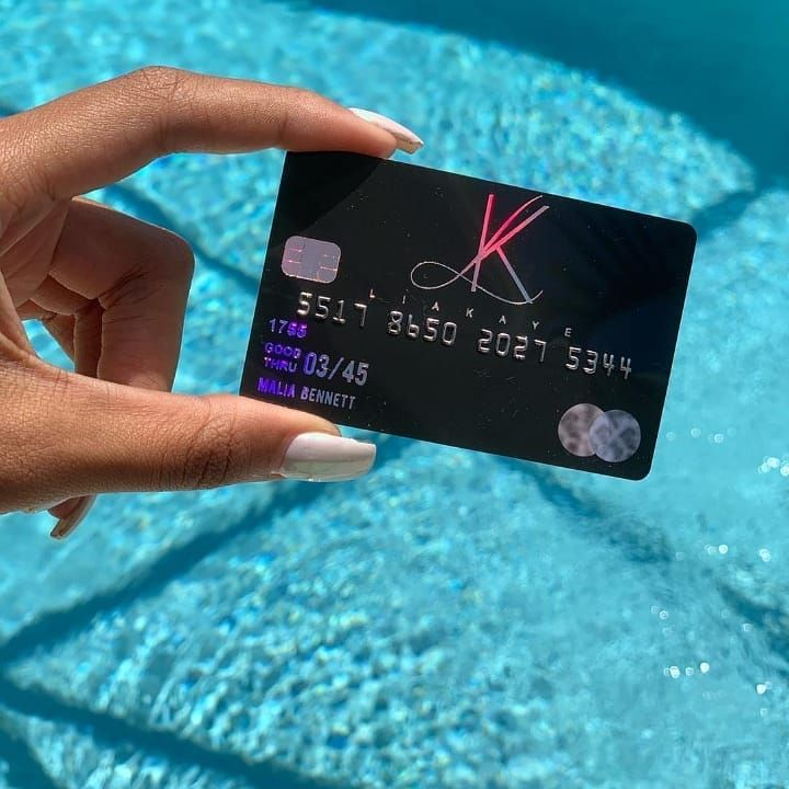 Black credit cards with holographic foil designed and