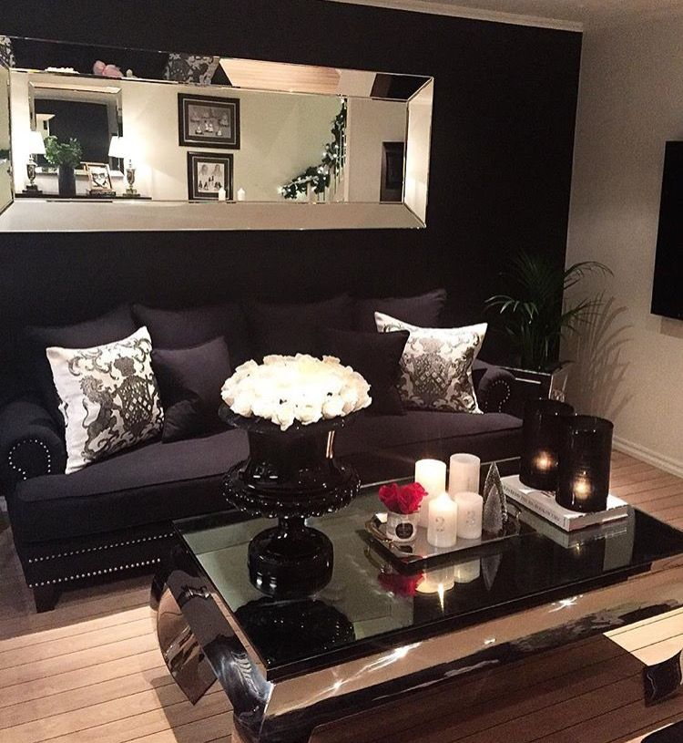 Love but I wouldn\'t do a black wall with a black couch ...