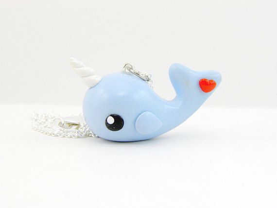 Hey, I found this really awesome Etsy listing at http://www.etsy.com/listing/103046545/kawaii-blue-narwhal-with-heart-necklace