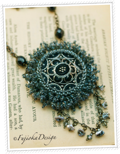 Handmade: Vintage style glass button from the Czech Republic, Swarovski crystals, Japanese seed beads, fresh water pearls, Czech glass, gunmetal chain....