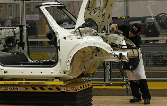 An employee works on a 2013 Mini at BMW's plant in Oxford, southern England November 18, 2013. REUTERS/Suzanne Plunkett - http://www.reuters.com/article/2014/02/17/us-bmw-mini-netherlands-idUSBREA1G0UL20140217