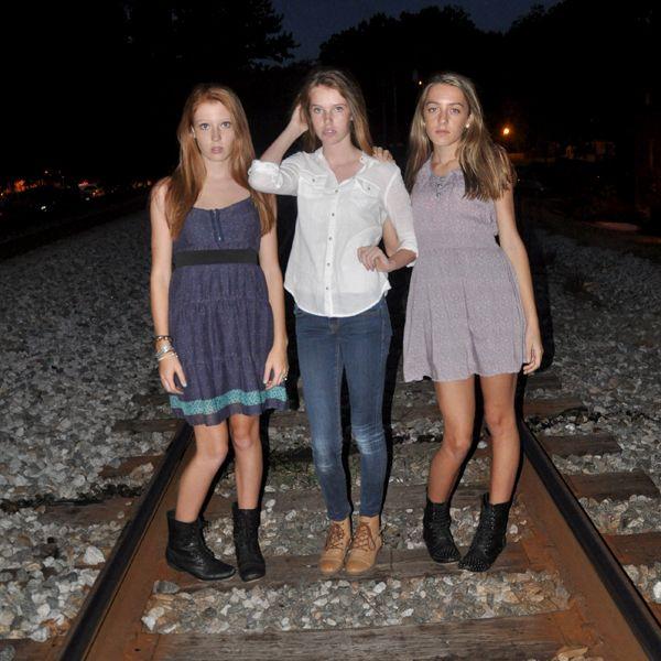 Three friends pose on railroad track. | Friends Photo ...
