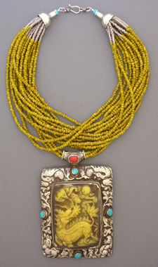 Addition of a pendant on one or two of the strands instead of all