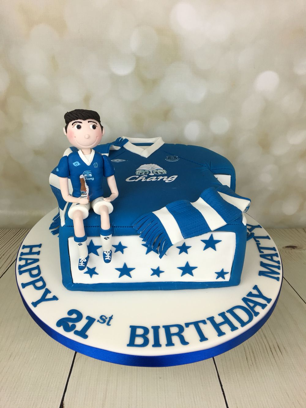 Everton FC football shirt cake with figure of the birthday boy in an