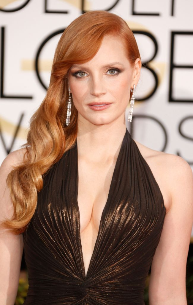 Her golden globes redhead