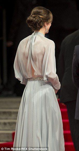 Her gown showed a sliver of bare back...