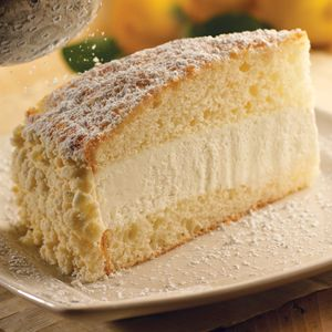 Olive Garden Lemon Cream Cake Delicate white cake and lemon cream filling with a vanilla crumb topping.