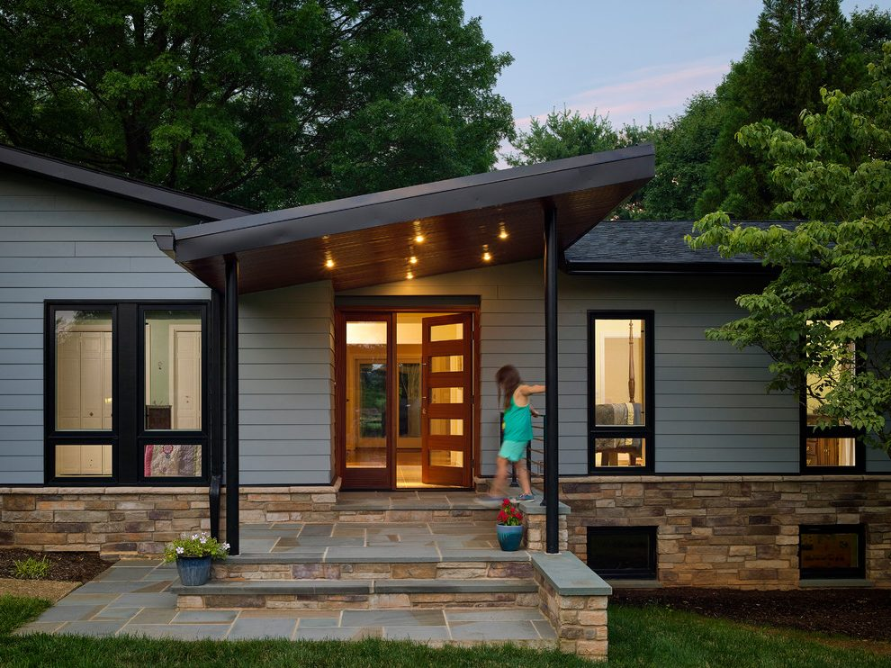 Front Entry Exterior Midcentury With Dark Gray Siding Black Slab Doors Modern Front Porches Modern Farmhouse Exterior Exterior House Colors