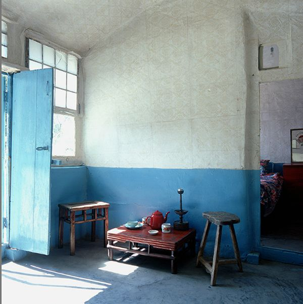 Rustic blue- I like the idea of painting the bottom half of the wall like this, especially with high ceilings such as this.