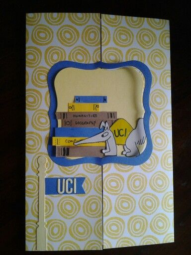 Off to college card. Its a gate fold with interlocking framlet pieces. Obviously the student is going to Irvine, and yes, books aren't really it anymore, but they work.