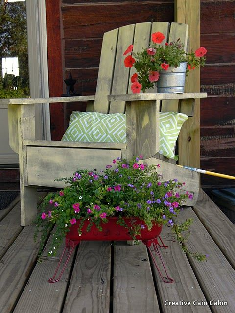 Adirondack chair, also notice the upcycled grill turned flower planter