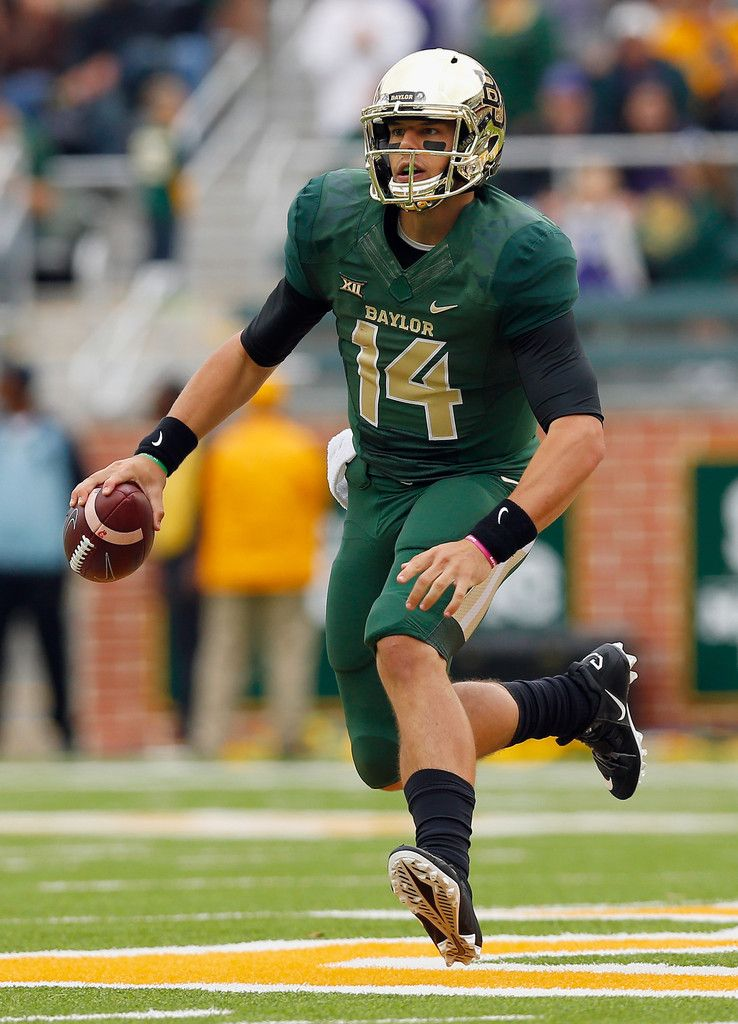 Bryce Petty 14 of the Baylor Bears scrambles with the