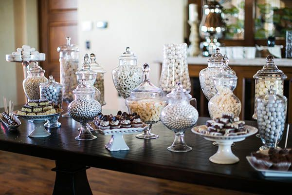 Gl Apothecary Jars On A Kings Table For An Elegant Candy Bar Luxury Estate Weddings