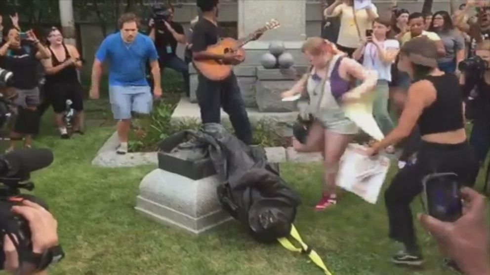 Now Playing: Counterprotesters in Charlottesville, Va., burned a Confederate flag       Now Playing: New Orleans removes 3rd Confederate monument       Now Playing: Protesters topple Confederate statue in Durham       Now Playing: Great American eclipse is nearly here       Now Playing: White... - #Confederate, #Durham, #Protesters, #Statue, #TopStories, #Topple, #Video