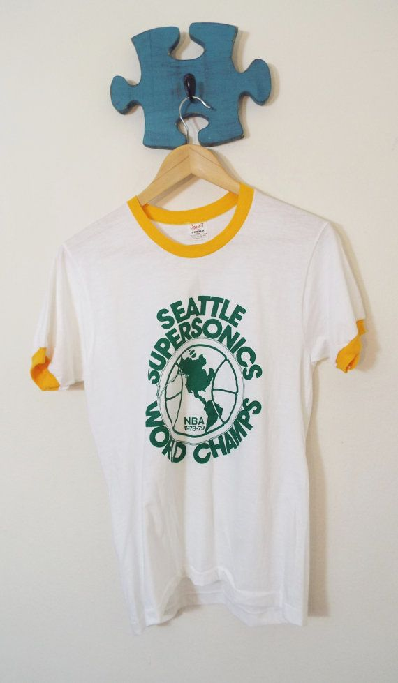 ff4011d9f9c2 $275.00 White Tee, yellow trim, green design. 78-79 World Champs. 100 %  pre-shrunk cotton. By Sport-T by Stedman Color: White Material: 50-50