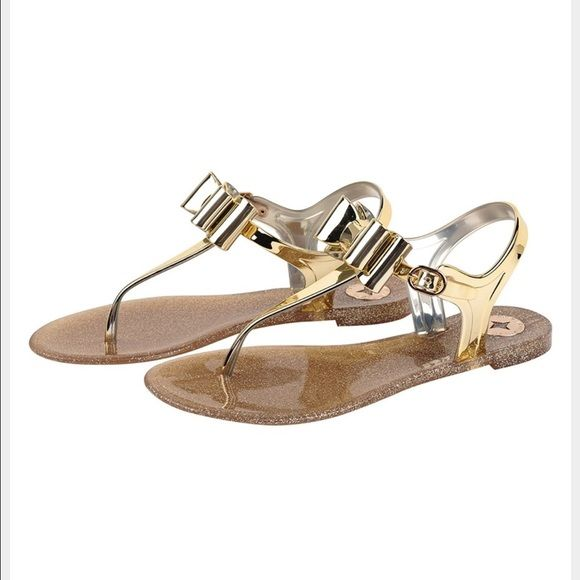 50596339ef26 BCBG Sandals Cute BCBG Gold jelly thong sandals with a bow. Only worn once. BCBGeneration  Shoes Sandals