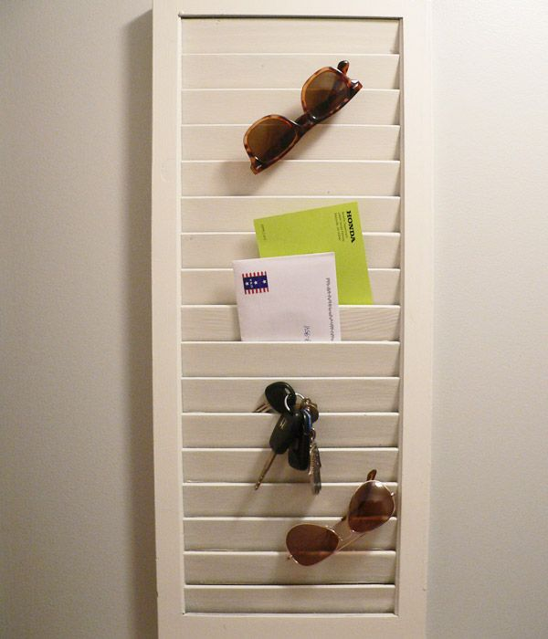 repurpose an old shutter as a hanging organizer for keys, mail, glasses, etc!