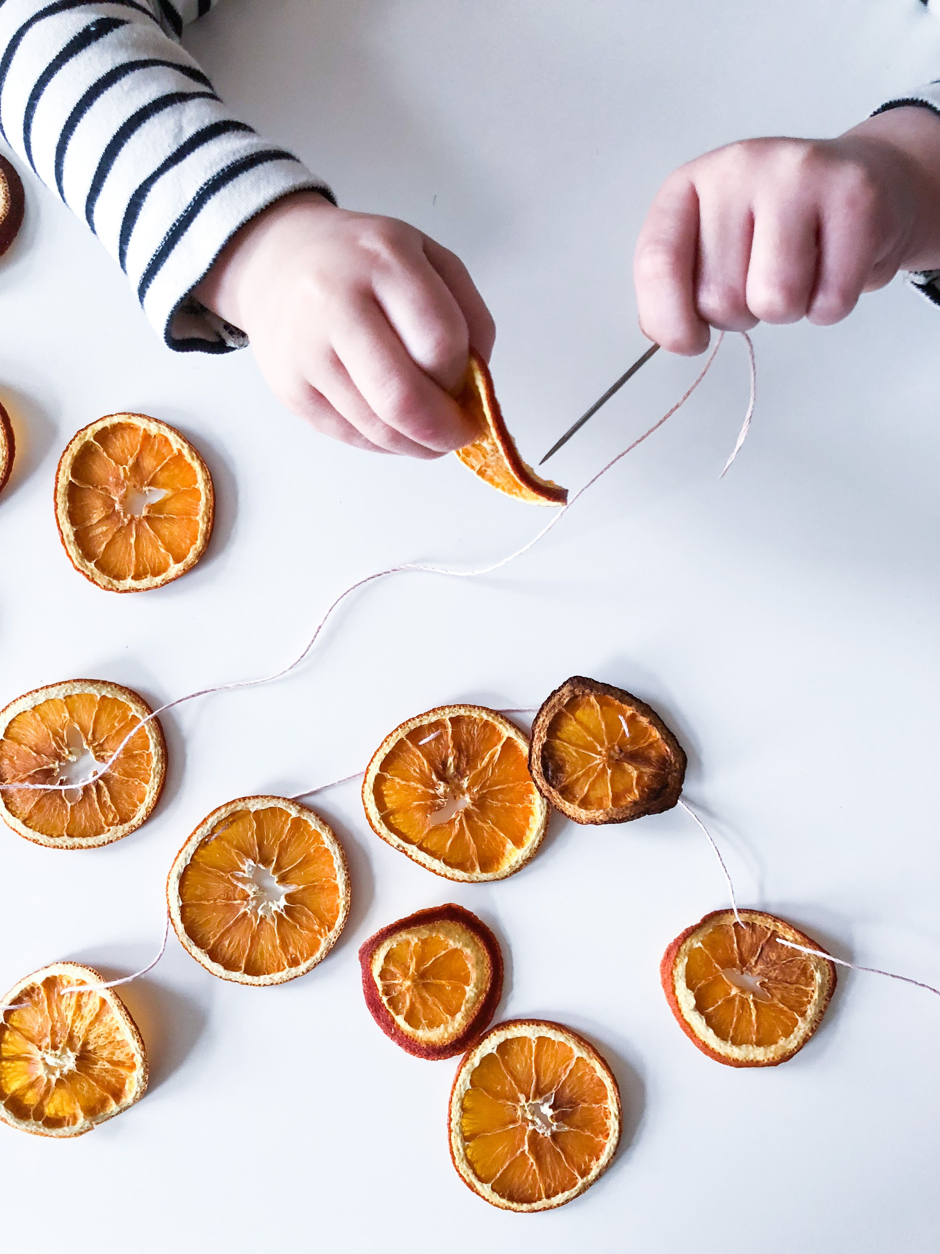 Photo of Christmas DIY garland from dried orange slices