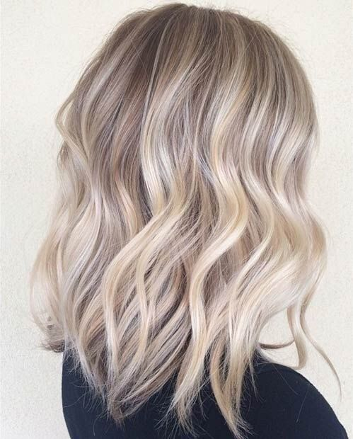 långt blont hår frisyr