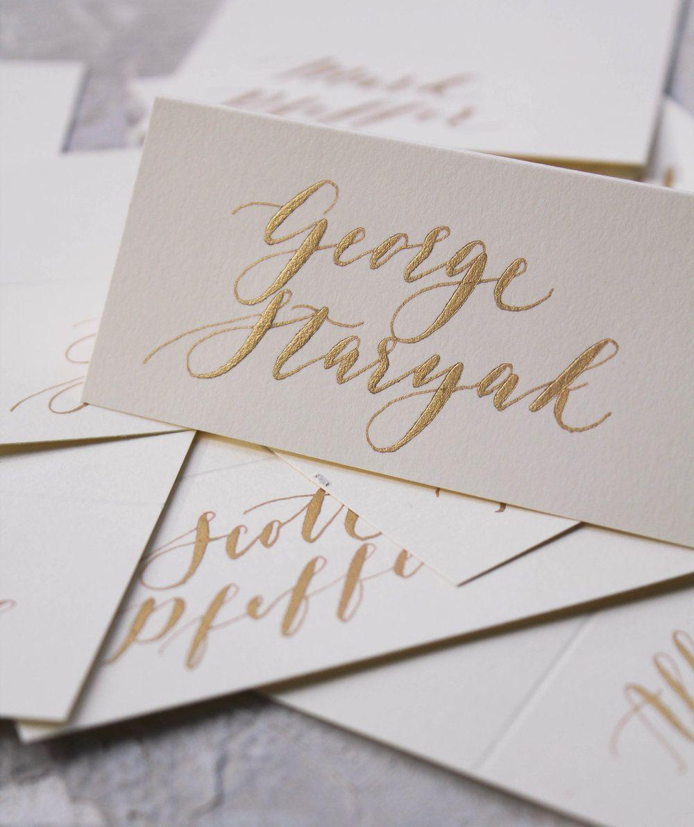 Fun chic wedding table arrangements Natural agate slice place card alternative Handwritten calligraphy in art nouveau script in gold ink