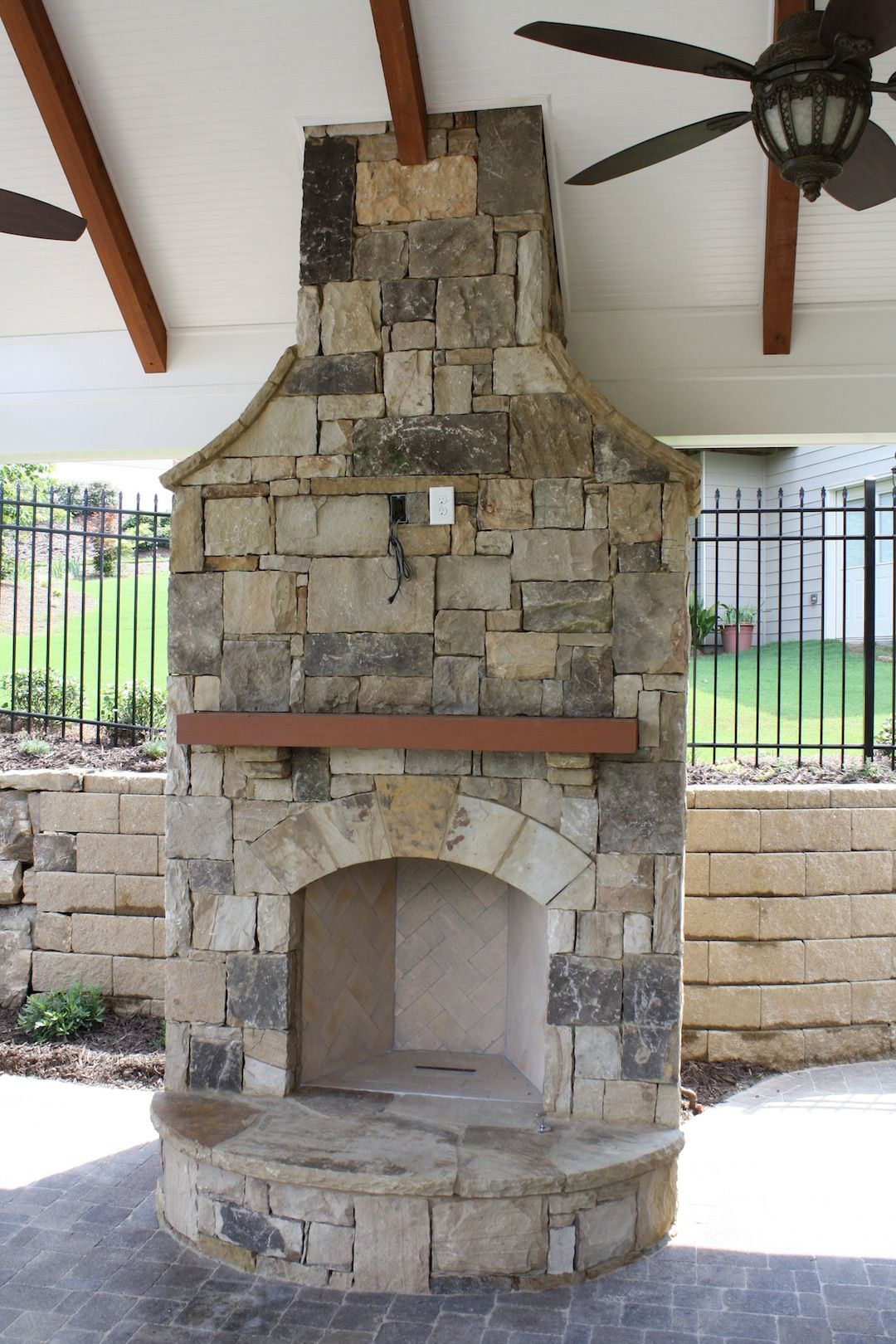 cabana with stone fireplace with wood mantel fireplaces and